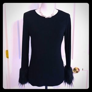Long sleeve with faux fur at wrists.
